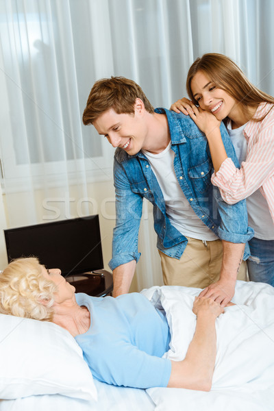 Couple visiting sick senior woman Stock photo © LightFieldStudios