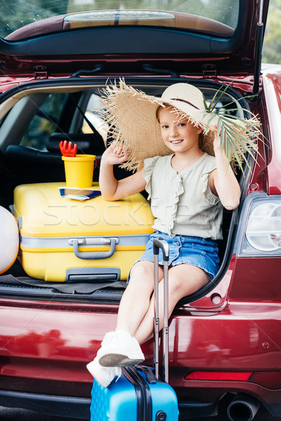travelling girl sitting in car trunk Stock photo © LightFieldStudios