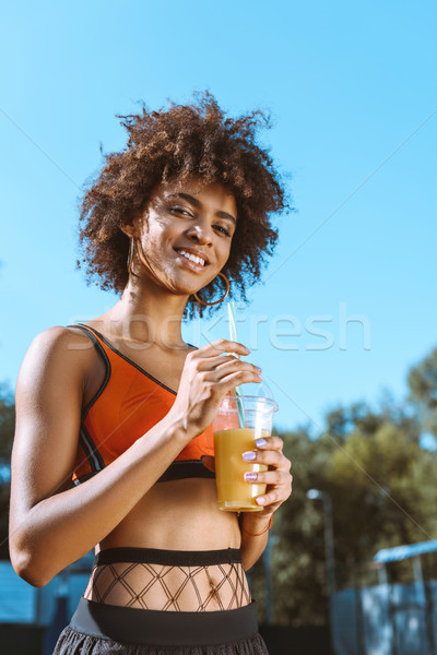 fit african-american woman drinking juice Stock photo © LightFieldStudios