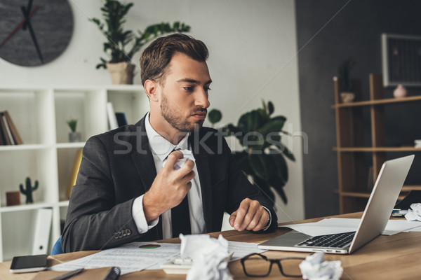Stock photo: businessman with crumpled papers