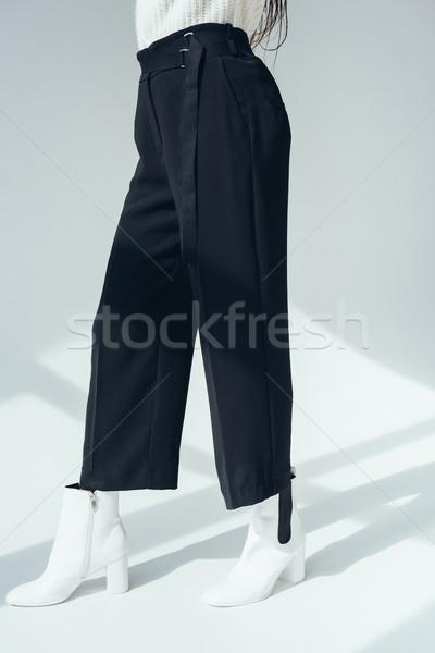 Lány trendi fekete nadrág alacsony részleg divatos Stock fotó © LightFieldStudios