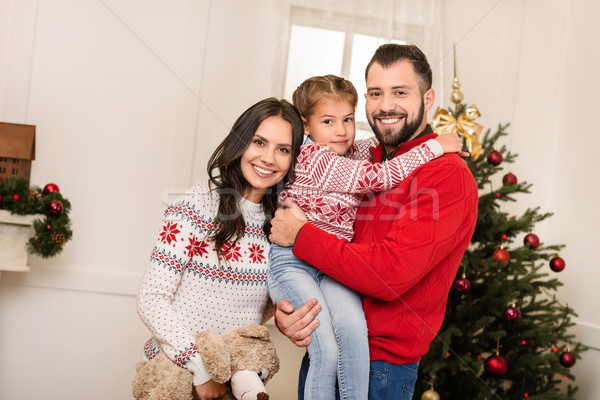 happy family with teddy bear at christmas Stock photo © LightFieldStudios