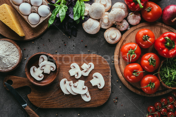 top view of various raw ingredients for pizza on concrete surface Stock photo © LightFieldStudios