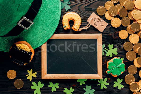 top view of empty board with gingerbread and shamrock on table, st patricks day concept Stock photo © LightFieldStudios