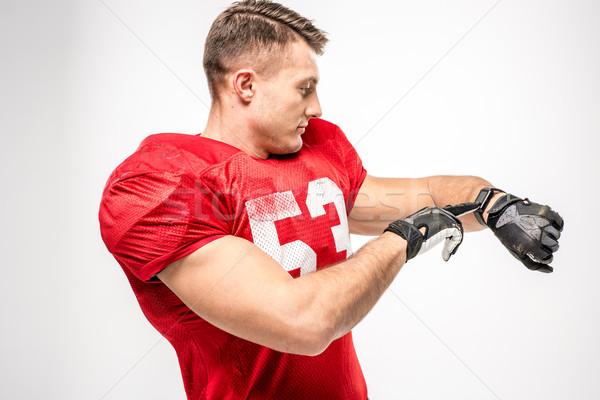 Football player pointing on smartwatch Stock photo © LightFieldStudios