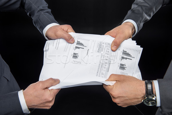 Businesspeople fighting for documents Stock photo © LightFieldStudios