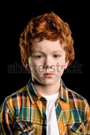 portrait of adorable redhead boy with crossed arms looking at camera isolated on black  Stock photo © LightFieldStudios
