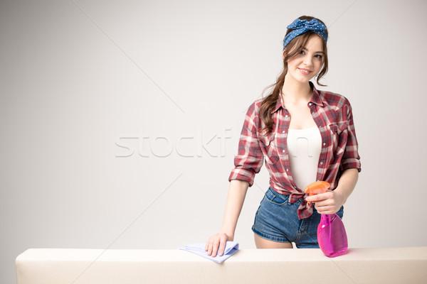 Woman cleaning surface  Stock photo © LightFieldStudios