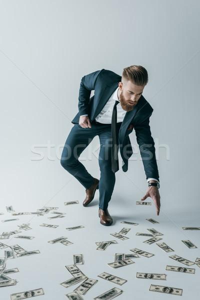 Elegáns üzletember szőlőszüret felfelé dollár bankjegyek Stock fotó © LightFieldStudios