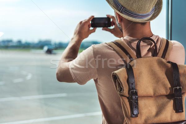 man taking picture on smartphone Stock photo © LightFieldStudios