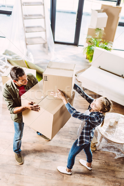 Stock photo: couple with cardboard boxes in new house