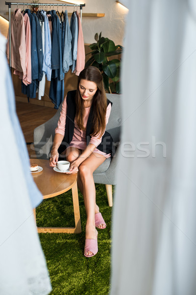 girl drinking coffee in boutique Stock photo © LightFieldStudios