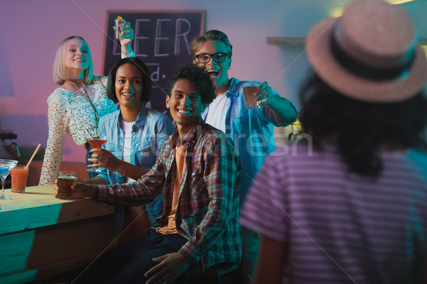 multicultural people greeting friend at party Stock photo © LightFieldStudios