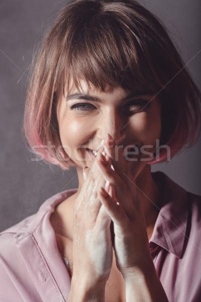 smiling girl with pink hair Stock photo © LightFieldStudios