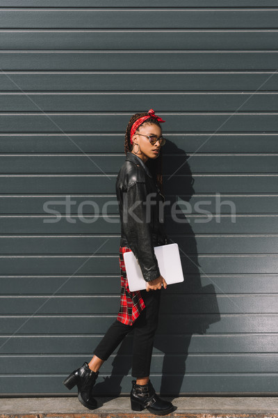 stylish african american girl with laptop Stock photo © LightFieldStudios