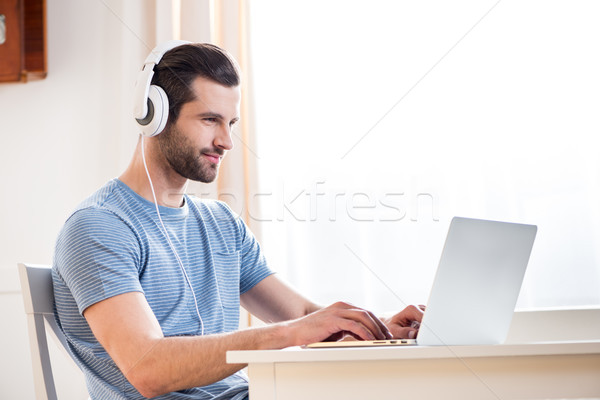 Man using laptop Stock photo © LightFieldStudios