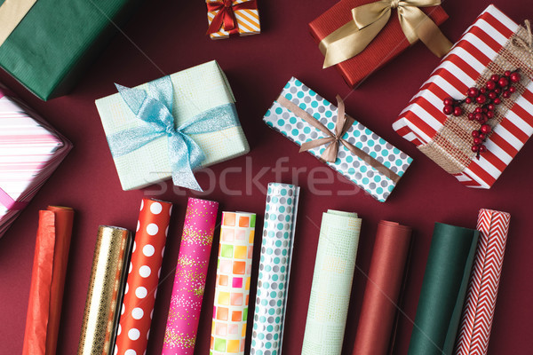 christmas presents and wrapping papers Stock photo © LightFieldStudios