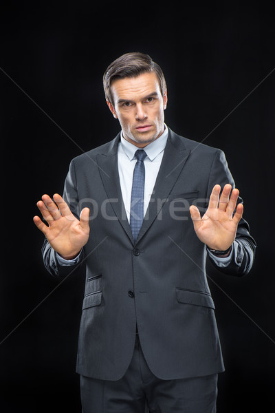 Handsome businessman gesturing Stock photo © LightFieldStudios