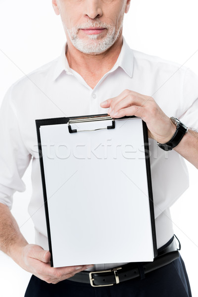 Stock photo: Man holding clipboard