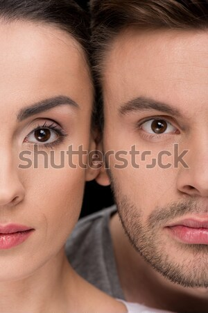headshot of serious woman and man looking to camera on black Stock photo © LightFieldStudios