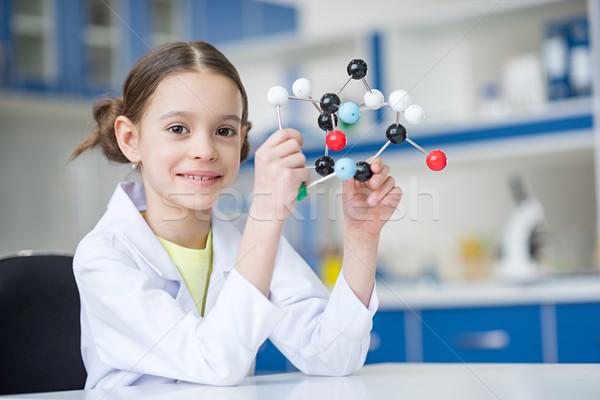 Kız bilim adamı laboratuvar önlüğü moleküler model Stok fotoğraf © LightFieldStudios