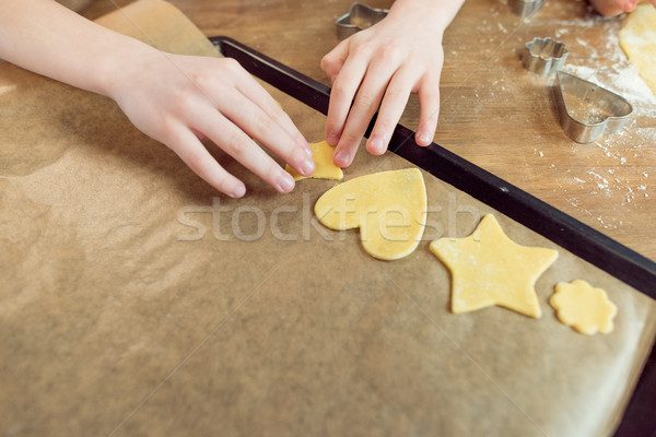 partial view of little kids making shaped cookies in kitchen Stock photo © LightFieldStudios