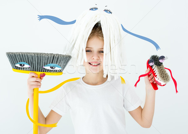 girl holding cleaning supplies Stock photo © LightFieldStudios