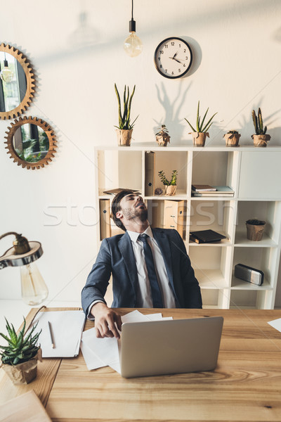 Young businessman napping in office Stock photo © LightFieldStudios
