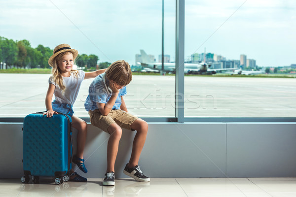 siblings waiting in airport Stock photo © LightFieldStudios