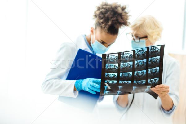 doctors examining x-ray photograph Stock photo © LightFieldStudios