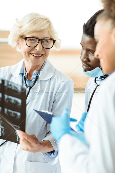 doctors examining x-ray photograph Stock photo © LightFieldStudios