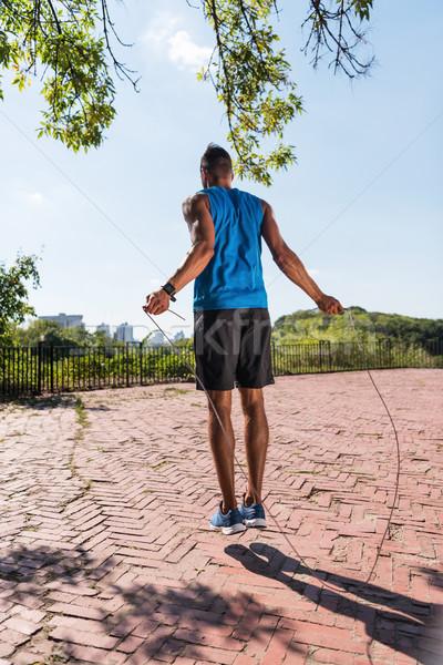 sportsman jumping on skipping rope  Stock photo © LightFieldStudios