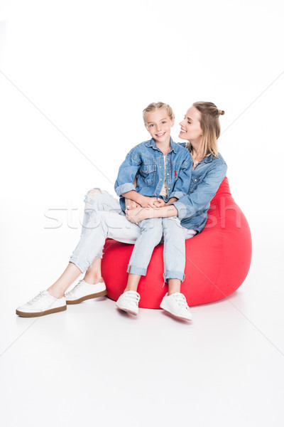 happy mother and daughter on bean bag Stock photo © LightFieldStudios