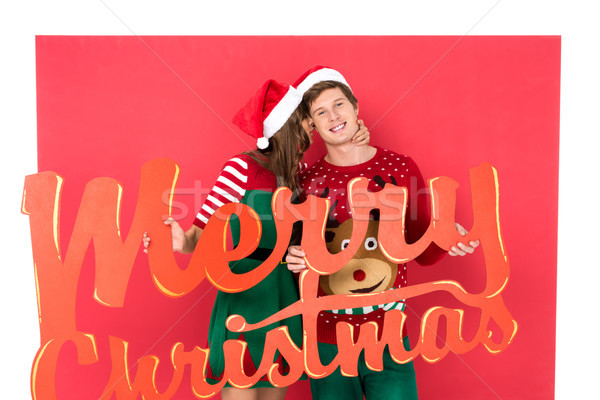 couple with merry christmas lettering Stock photo © LightFieldStudios