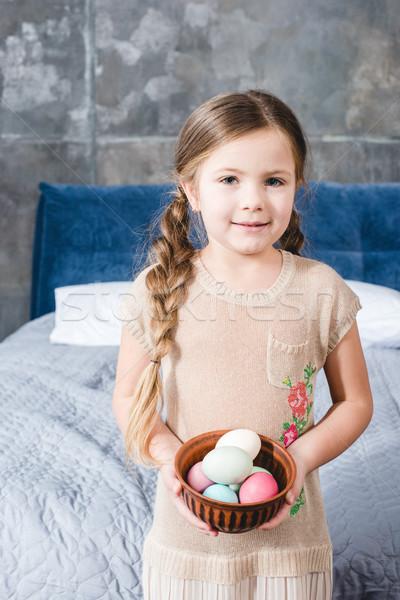 Girl holding Easter eggs Stock photo © LightFieldStudios