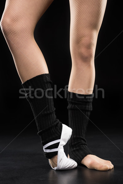 Close-up partial view of woman dancer in ballet shoe posing on black Stock photo © LightFieldStudios