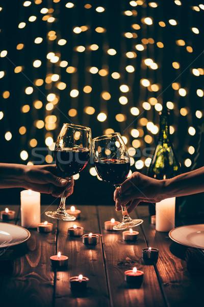 Women clinking glasses at dinner Stock photo © LightFieldStudios
