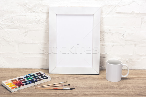Vazio photo frame tabela ver xícara de café Foto stock © LightFieldStudios