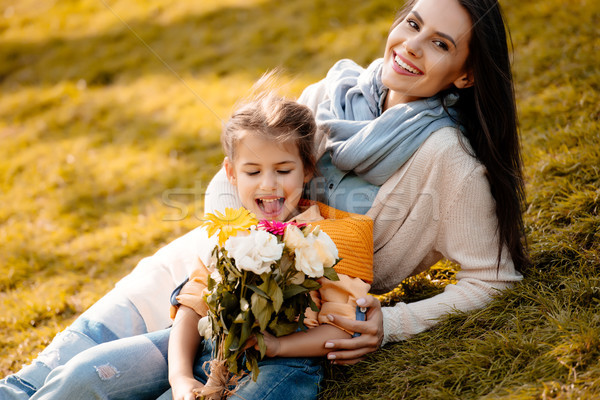 daughter and mother with bouquet Stock photo © LightFieldStudios