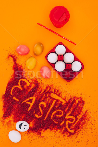 top view of easter sign made of red sand with chicken eggs and coffee on orange Stock photo © LightFieldStudios