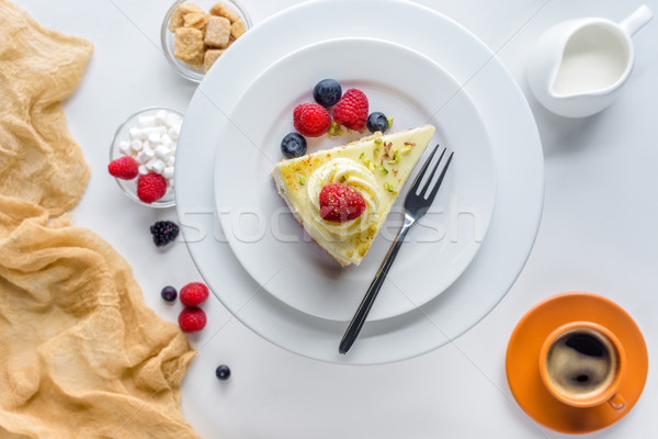 top view of piece of cake with berries on white table Stock photo © LightFieldStudios