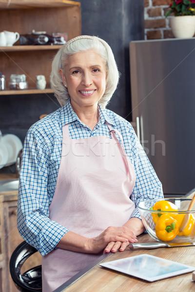 Senior woman in apron  Stock photo © LightFieldStudios