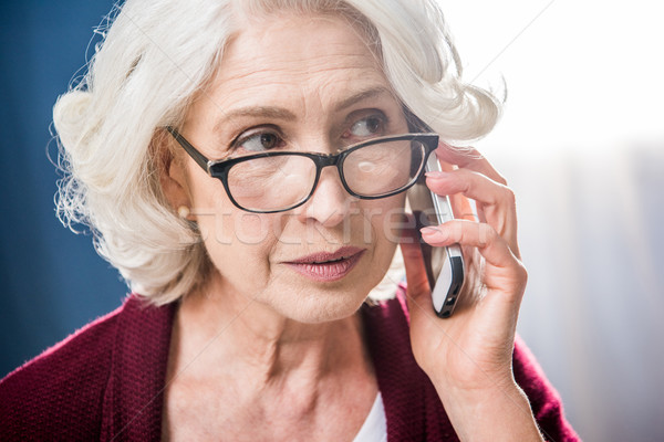 Stock photo: Woman talking on smartphone