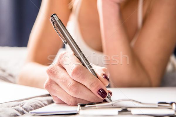 Girl making notes  Stock photo © LightFieldStudios