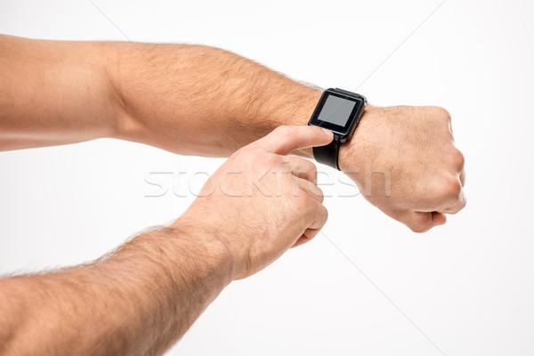 Man pointing on smartwatch Stock photo © LightFieldStudios