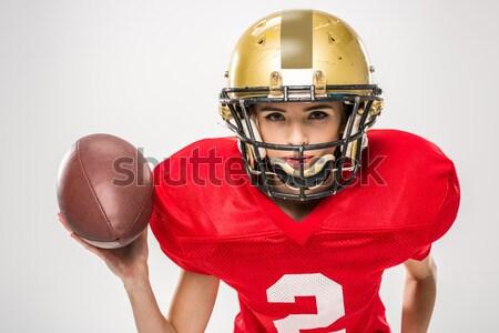 Amerikai futballista pózol labda gyönyörű női Stock fotó © LightFieldStudios