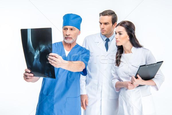 Doktorlar xray görüntü üç birlikte Stok fotoğraf © LightFieldStudios