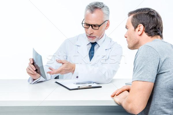 Doctor shows x-ray image  Stock photo © LightFieldStudios