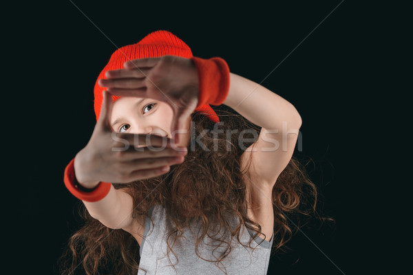 girl in sportive clothing obscuring face with hands isolated on black Stock photo © LightFieldStudios
