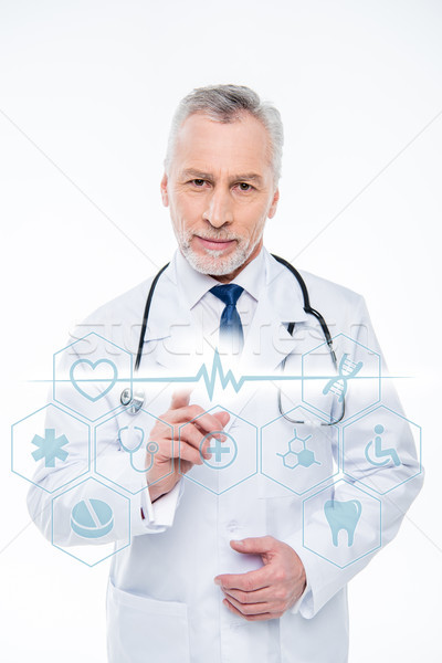 Stock photo: doctor with stethoscope and medical care icons